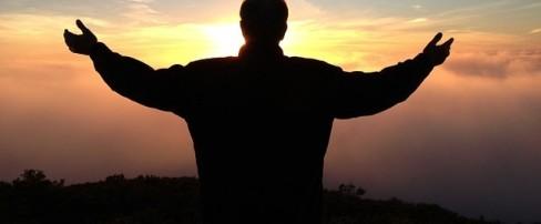 prayer with arms raised